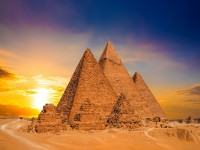 Great Pyramids of Giza Egypt at sunset iStock 908333476