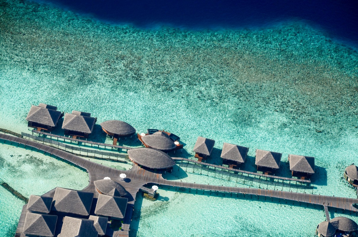 Bird's eye view of accommodation over the water in Maldives