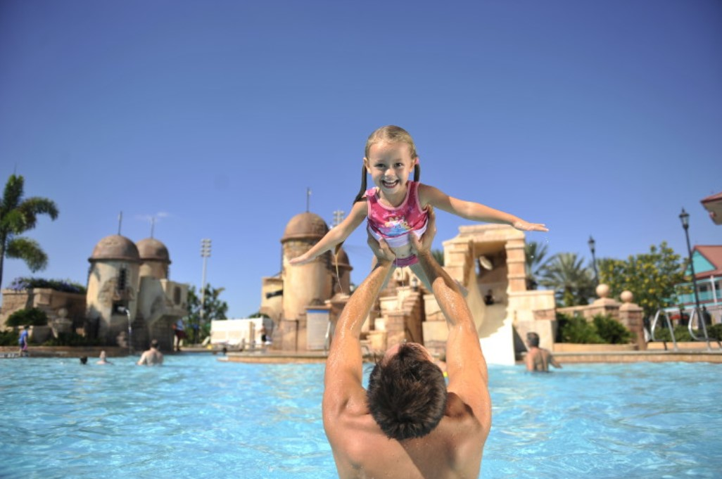 Exclusive Disney Resort Hotel Benefits - girl and dad in pool