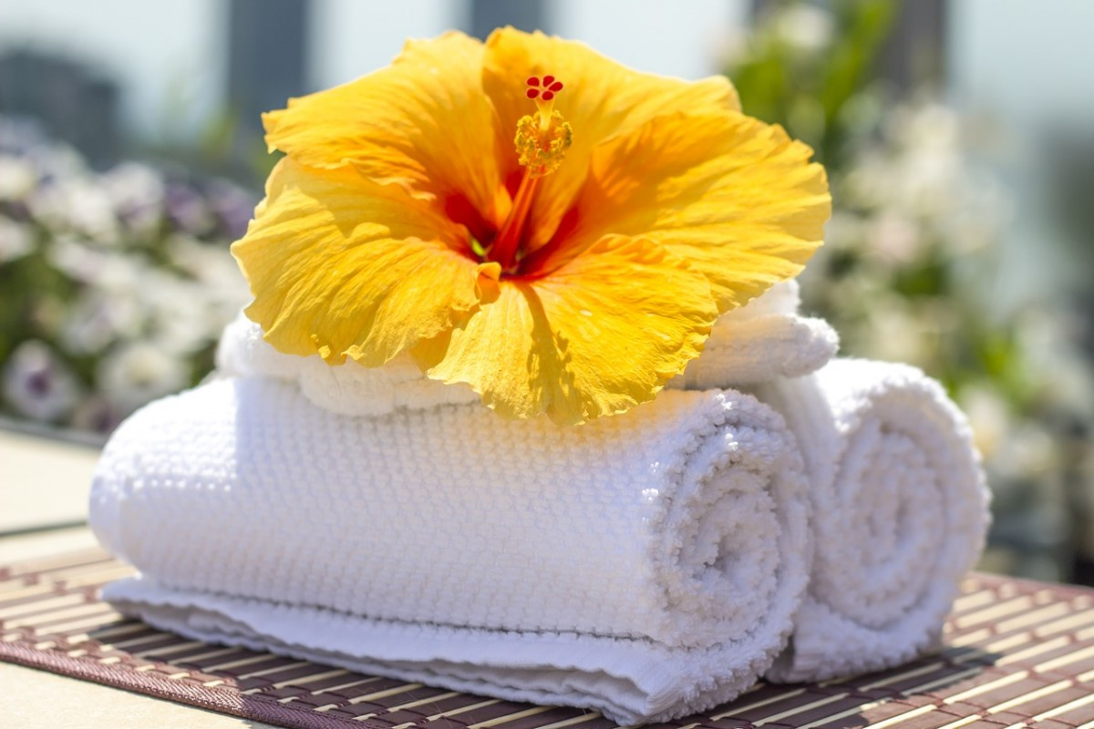 Hibiscus flower on towels at a luxury resort